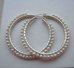 Wire Wrapped Swarovski pearl hoops by perfect on Etsy, $67.50 All purchases benefit Compassion!