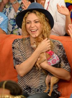 "Shakira snuggles with a Chihuahua during an appearance on ""Despierta América"" on July 9 in Miami"