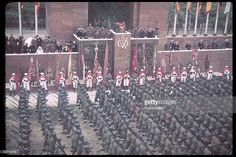 Spanish General Francisco Franco (1892 - 1975) stands at the center of a reviewing stand during the victory parade in honor of his Nationalist…