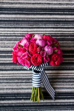Fuchsia and striped ribbon. Artisan Events Floral Decor.  Photography: Candice Benjamin Photography - candicebenjamin.com  Read More: http://www.stylemepretty.com/little-black-book-blog/2014/07/01/modern-viceroy-palm-springs-wedding/