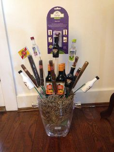 Perfect gift for my father in law. Wine bucket bouquet with sangria, liquor and Cigars. I used so much hot glue he had a hard time getting it apart! Liquor Bouquet, Wine Bucket, Sangria, Cigars, Fun Stuff, Barware, Law, Father, Spring