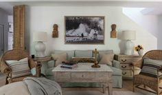 """Ginger Barber's townhome: Her signature look """"is soft, muted linen upholstery and seagrass- casual and livable. Religious colonial figures, wooden gilded crosses and books are also necessary frills."""""""
