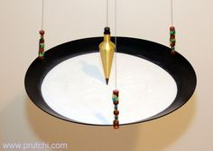 DIY sand pendulum.... I'd like a zebra print bowl with red sand. :D  Another project for my poor husband!!