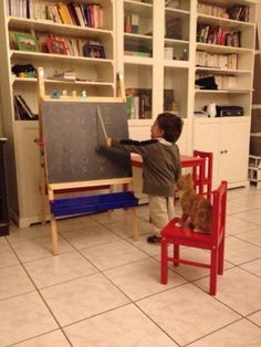 This boy schooling his best friend in the ABCs. | 42 Pictures That Will Restore Your Faith In Cute