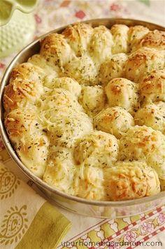 Garlic Cheese Pull-Apart Bread 16 frozen white dinner rolls (Rhodes brand) ½ C butter, melted 1 C grated Parmesan cheese, divided 1 tsp dry parsley flakes 1½ tsp garlic powder ½ tsp salt ½ tsp Italian seasoning ½ tsp onion powder