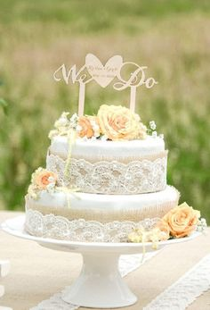 Burlap and lace wedding cake idea with 'We Do' topper from For Love Polka Dots