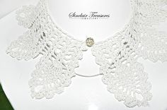 Very beautiful lace collar crocheted in white with light gray and metallic silver, this very pretty collar can be worn with the button in