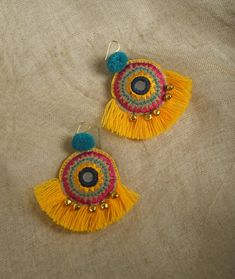BOHO EARRINGSEmbroidered round shape earrings, beautifully embroidered and made funky with bright yellow fringe.Multicolour thread embroidery makes it easy to c Tribal Earrings, Fringe Earrings, Diy Earrings, Earrings Handmade, Crochet Earrings, Yellow Earrings, Pendant Earrings, Mandala Jewelry, Boho Jewelry