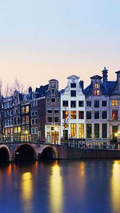 Amsterdam by night. (Photo via joseph maia on Pinterest)