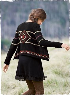 The graphic cropped cardigan is patterned in Zuni geometrics of copper, plum and stone on black. Handloomed of cozy baby alpaca (70%) and wool (30%) with a crewneck and extra-long ribbed cuffs.