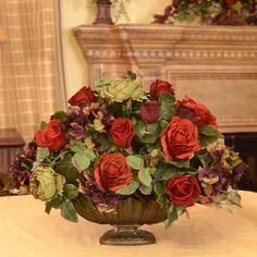 Garnet Silk Flower Centerpiece with Roses, Hydrangeas and Berries AR319 - Beautifully designed centerpiece in resin bowl adds a lovely accent to your homes décor. Created wth deep reddish burgundy roses, hydraneas, and ranunculus. 24L x 20 H