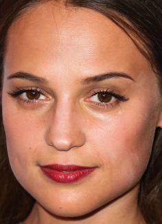 Close-up of Alicia Vikander at the 2016 Women in Film Pre-Oscar Cocktail Party.
