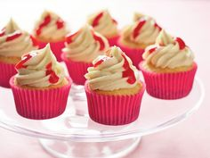 New York Cheesecake Cupcakes : A combination of gluten-free cookie crumbs and baking mix is the star of these cheesecake-style cupcakes, which are topped with vanilla-cream cheese frosting and some in-season raspberry coulis.