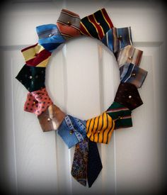 This is a fun, OOAK handcrafted wreath made from upcycled neckties in colorful hues and bold designs. The perfect accent for Dad's special day!! Also makes a great everyday door or wall adornment for his office, the boys' room, the game room...
