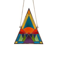 Extra big handmade stained glass triangle by David Scheid Sunset motif. I'll take one in every color thank you very much.