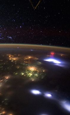 """Astronauts on board the International Space Station recently captured two photos of rare, mysterious """"red sprites"""" — atmospheric phenomenon associated with powerful thunderstorms on Earth"""