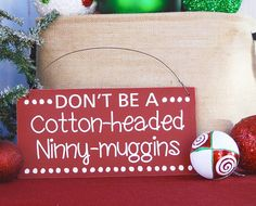 "Time to start thinking of decorating? We are! See more at https://www.etsy.com/shop/SignsStuffnThings/items?section_id=13351910 ""Don't be a Cotton-Headed Ninny-muggins"" So funny and cute. We are offering three colors of this design. These signs are so popular, don't wait to order yours. Each sig... #handmade #christmassigns #elfchristmas #elfmovie #reindeernames #christmasdecor #sign #holiday #housewares #ninnymuggins #buddy #ninny-muggins #quote #movie"