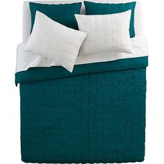 Modern quilt squares up textural blocks in blue-green with contrasting white handstitched detail. Soft 100% cotton quilt and matching shams ...