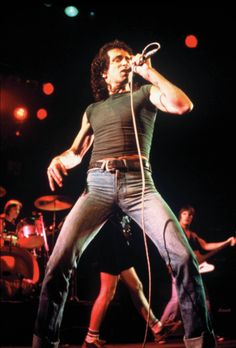 Bon Scott channelling the gods of rock to enter through his dirty denim and exit out his bourbon hole.
