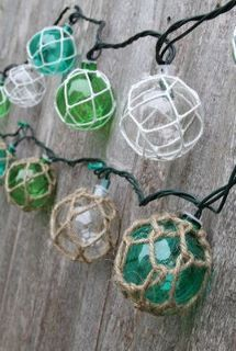 """Imagine these wonderful """"glass"""" float string lights illuminating your patio while you relax with a tropical drink on a warm summer's evening. (Ok so the bulbs are actually made of sturdy plastic - real glass would be too heavy)."""