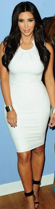 Who made  Kim Kardashian's white pleated dress and black sandals?