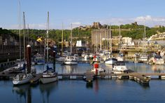 Panorama of Dover Castle and Wellington Dock near Sunset, Dover Marina, Kent, England, UK. Yachts and boats in the non-tidal dock that was named after the Duke of Wellington, victor of the 1815 Battle of Waterloo and later Lord Warden of the Cinque Ports. A Listed Building. Snargate Street on the left and part of Dover Marina Hotel and Spa on the right. Dover Castle on skyline. View from near A20 Prince of Wales roundabout. Travel and Tourism. See: http://www.panoramio.com/photo/52447076
