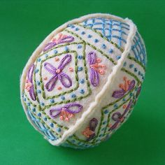 For NEXT year!!! Free pattern and tutorial: Embroidered felt Easter eggs by Wendi Gratz of Shiny Happy World