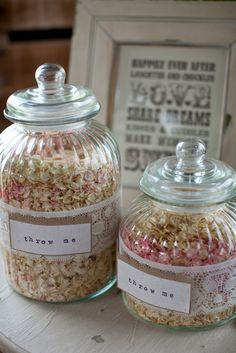"""Could fill apothecary jars with this, and lay burlap or paper sacks next to it for guests to fill their own.  """"Our beautiful Pale Pink and Ivory Delphinium Petals as seen in You & Your Wedding magazine. Photo by Segerius Bruce Photography, styling  Helen Carter Weddings."""""""
