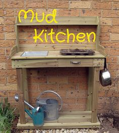 Mud kitchen - would be awesome as a combined gardening work space (it's a potting table) and play area for muddy play. Awesome idea!