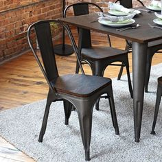 Oregon Metal Dining Chair, Set of 2                Industrial antiqued finish on metal legs and a backrest are combined with an espresso finished bamboo seat to create this contemporary Oregon Metal Dining Chair, Set of 2. These accent chairs are being sold as a set of two. Metal chairs are the perfect addition to your farmhouse decor.