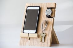 Wooden phone stand holder for iPhones and phones, watches, keys.