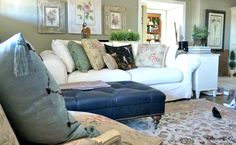 A photo of one of my projects... Music Room (piano in foreground)  washable slipcovers on Ballard Design sofa makes it easy to have white or keep a room clean...  character shoes and toys on the floor