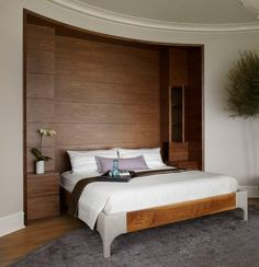 Hidden built in bedroom storage for a contemporary bedroom by Morgante Wilson Architects.