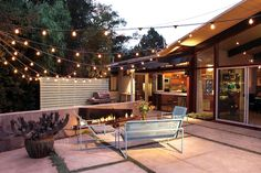 Magnificent Kichler Outdoor Lighting trend Santa Barbara Midcentury Patio Decorating ideas with backyard cactus container plants exterior lighting metal patio furniture midcentury modern modern fire pit