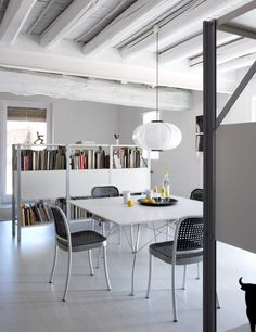 White square dining table, love those chairs too.