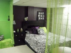 Tween room makover using purple (Plummet by Sherwin Williams) and lime green/neon green (Outrageous by Sherwin Williams)  with a dash of zebra print and black furniture.