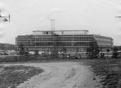 Reynolds Metals Company Headquarters under construction in 1958, 6601 West Broad Street. Black and white photograph of a large office-type building under construction; some scaffolding is visible in front of the building; a wooden fence an a dirt road are in the foreground of the photo; notations on verso of print identify the building as the headquarters of Reynolds Metals Company, 6601 West Broad Street. | V.58.202.65 Richmond History Center - Richmond Newspapers, Inc.