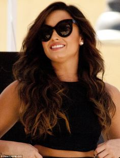 Shady lady: Fashion forward Demi opted to wear a pair of comically oversized frames...