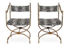 Vintage French Antiqued brass chairs with zebra-print seats!  Love!