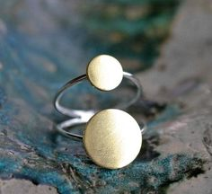 A stellar sterling-and-brass ring that will send your style soaring. #etsyjewelry