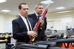 Russian Prime Minister Dmitry Medvedev (L) and Russian Deputy Prime Minister Dmitry Rogozin during a visit of the arms factory ORSIS, owned by the Promtechnologies Group, on November 19, 2013 in Moscow, Russia. ORSIS produces high-precision hunting, sport and tactical rifles.