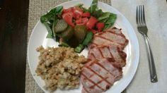 Mediterranean rubbed grilled pork chops, apple stuffing,freah salad and packos sweet pickles.