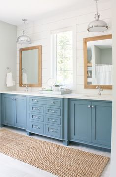 Lake House Blue and White Master Bath List – (Disclosure- contains affiliate links)  Wall Paint colors – Silver Strand and Extra White by Sherwin Williams  Cabinet Paint – Blustery Sky by Sherwin Williams  Faucet – Delta Cassidy Single Lavatory Faucet  Flooring – BuildDirect Salerno Porcelain Tile Wilderness Series  Cabinet – Ikea  Mirrors – Hobby Lobby  Countertop – Misterio quartz by Vicostone  Bathtub – Signature Hardware  Lights – Quorum
