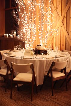 We love the neutral tan, taupe, and brown pine cone color scheme at this winter wedding in Colorado's Devils Thumb Ranch.  The lit bare branch trees make a beautiful backdrop.  #winter #wedding #decorations