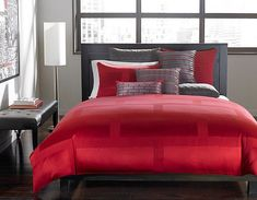 Hotel Collection bedding in red adds drama to the gorgeous bedroom [From: Hotel Collection]
