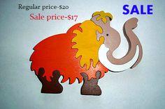 Ce mammouth « Funny » est un jouet de 7 pièces de puzzle. Pièces en bois colorés et grand aident à développer la coordination oeil-main,…
