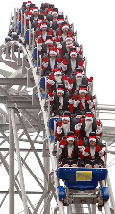 Lots of Santa's having fun..... I would absolutely do this!  Grab a group of friends, throw on your Christmas hats...and scream bloody murder