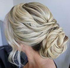 Gorgeous twisted back bun wedding hairstyle; Featured Hairstyle: Heidi Marie Garrett