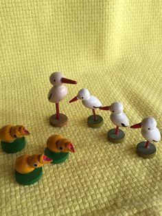 Vintage German wooden figures, chicks and storks