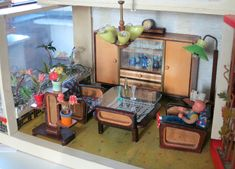 "Communist Dollhouses: Stasi Chic in Miniature - Cold War-era furnishings, kitschy wallpaper and fine examples of mid-century architecture from the German Democratic Republic, there's a huge collection of ""Soviet chic"" German dollhouses on Flickr,  hailing from the short-lived era when East Germany was under communist rule, for all your nostalgic Stasi needs…"